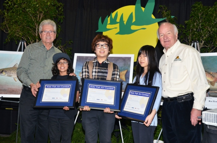 MPP Mike Colle, Eli Mathew, Yoo Bin Kang, Rae Tang and Walter Oster, CEO of the Canadian National Sportsmen's Shows, celebrate another successful Kids' Fish Art Contest.