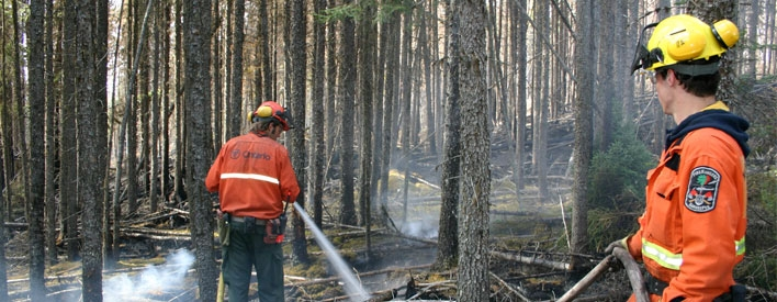 Ontario Fire crews put out smoldering embers.