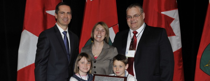 Premier Dalton McGuinty presents Paul and Rosie Hill of Willowgrove Hill, along with their children Joey and Maddie, with the Premier\'s Award for producing DHA Omega-3 enriched pork at the ceremonies for the 2010 Premier's Award for Agri-food Innovation Excellence held Monday, April 4, 2011 in Toronto.
