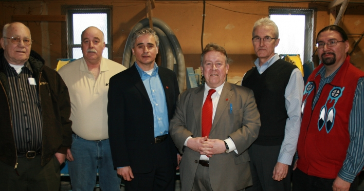 Michael Gravelle, Minister of Northern Development, Mines and Forestry, today announced that 11 forest product companies across Ontario have accepted wood supply offers from the Province. Shown with the minister (third from right) and Thunder Bay-Atikokan MPP Bill Mauro (third from left) are representatives of three companies in the Thunder Bay District (left to right): Basil and Sandy Smith - Garden Lake Timber, Roger Barber - AbiBow Canada Inc., and Chief Xavier Thompson - Pays Plat Firewood.