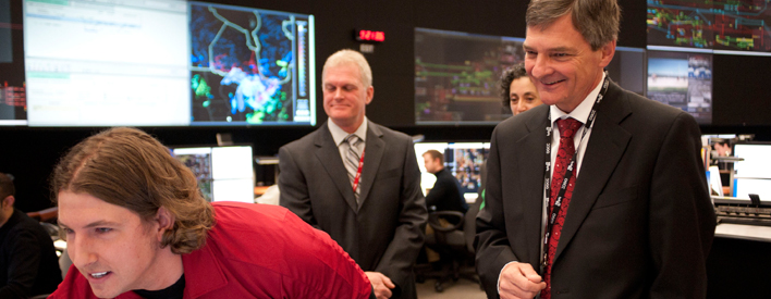 Energy Minister Chris Bentley learns about Hydro One's Ontario Grid Control Centre with Jeff Higenbottam, a system control technician and Georgian College graduate.