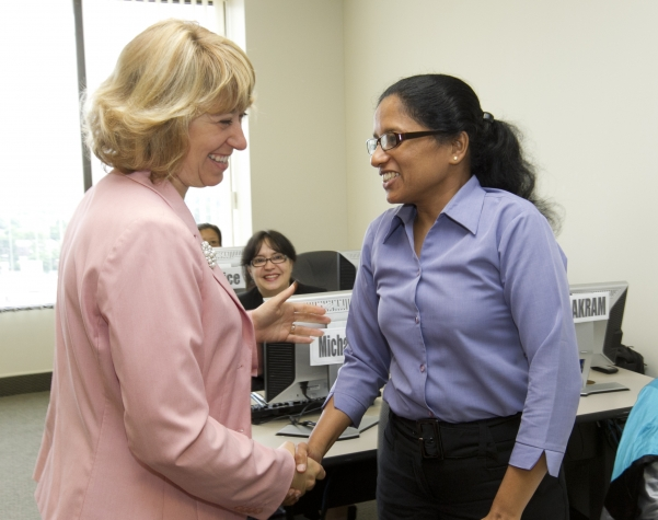A student welcomes Minister Broten to the Advanced Information Technology course at MicroSkills. This course is part of the Women In Skilled Trade and Information Technology Training program which helps low income women get jobs in one of Ontario's growth sectors.