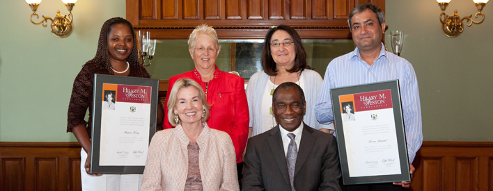 Bottom: The Honourable Hilary M. Weston seated next to Deputy Minister of Citizenship and Immigration Chisanga Puta-Chekwe. Above, from left: Scholarship recipient Regine King, Chair of the selection committee Lesley Cooper, committee member Rachel Birnbaum, and scholarship recipient Hiren Rawal.