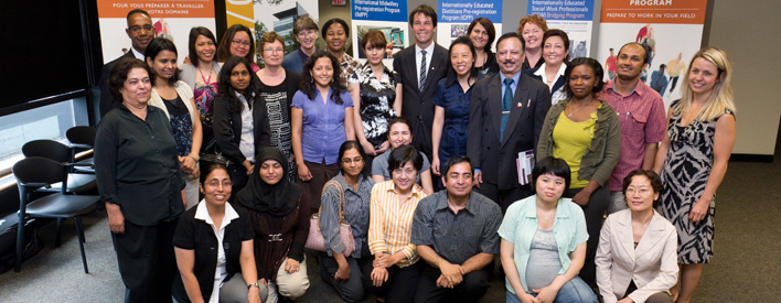 Recent Bridge Training graduates with Minister Eric Hoskins