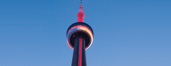The CN Tower lit up in the colours of the Medicine Wheel the evening 