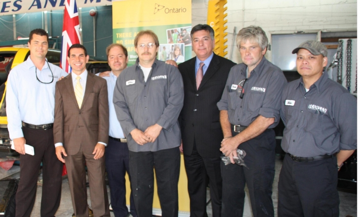 At Hawley Collision Centre. Back row from left: Mike Emerson and Dee Fernandes, Owners of Hawley Collision Centre; Charles Sousa, MPP Mississauga South. Front row from left: Peter Fonseca, Minister of Labour; Mike Chabot, Mark Omand and Merv Yabut, Hawley Collision Centre's Joint Health and Safety Committee