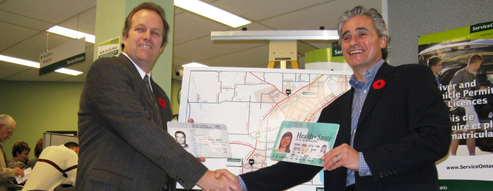 "ServiceOntario Regional Manager Moe Fenelon, left, shakes hands with Bill Mauro,   MPP for Thunder Bay-Atikokan  ""I am delighted we are the first city in the province to offer integrated services at our three local ServiceOntario centres,"" Mauro said."