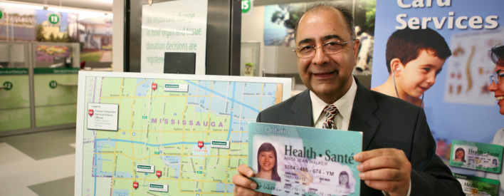 Government Services Minister Harinder S. Takhar displays a sample Ontario health card at a new ServiceOntario centre in Westdale Mall. The centre now offers Health Card services and Drivers Licence services will be added in 2010.