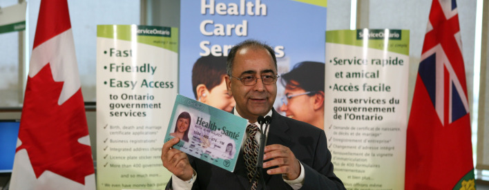 Government Services Minister Harinder S. Takhar displays a sample Ontario health card at a new ServiceOntario centre in Milton. The centre now offers Health Card services and Drivers Licence services will be added in 2010.