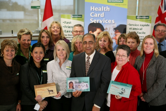 Government Services Minister Harinder S. Takhar displays a sample Ontario health card with staff showcasing samples of an Ontario drivers license and outdoors card at a new ServiceOntario centre in Milton. The centre now offers Health Card services and Drivers Licence services will be added in 2010.