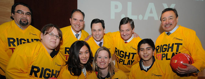Back Row:  Chief Norm Hardisty of Moose Cree First Nation, Robert Witchel of Right to Play, Minister Brad Duguid, Minister Chris Bentley, Grand Chief Stan Beardy of Nishnawbe Aski Nation.  Front Row:  Darlene Isaac, Aurora Delaney, Olympic and World Champion Sami Jo Small and Adrian Delaney.