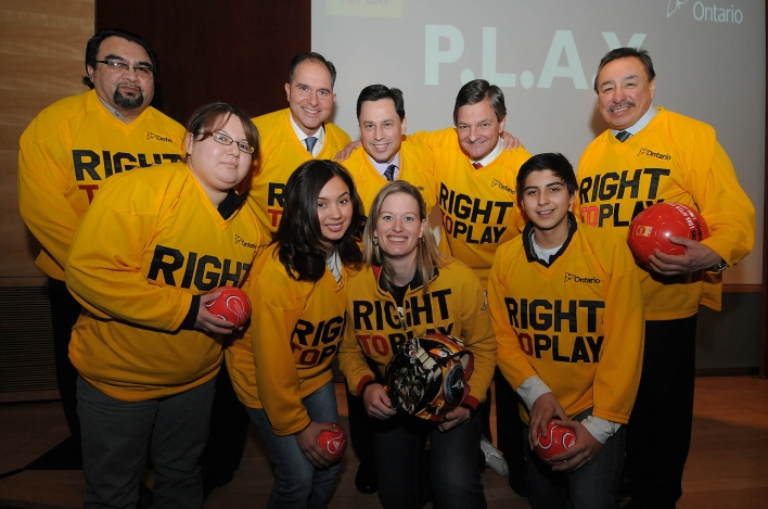 Back Row:  Chief Norm Hardisty of Moose Cree First Nation; Robert Witchel of Right to Play; Brad Duguid, Minister of Energy and Infrastructure; Chris Bentley, Minister of Aboriginal Affairs; Grand Chief Stan Beardy of Nishnawbe Aski Nation.  Front Row:  Darlene Isaac, Aurora Delaney, Olympic and World Champion Sami Jo Small and Adrian Delaney.