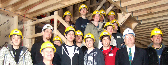 Students from six schools have begun building Harvesting House, an energy-neutral model home.  They are working next to local professionals, trades people and other community partners on this project.