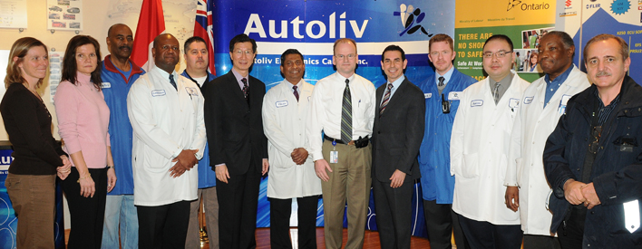 From left: Lisa Hooper, MOL Ergonomist; Zirka Puharski, APS Manager; Audley Gosling, Local Vice President, International Association of Machinists and Aerospace Workers (IAMAW); Lawrence Scott, Industrial Engineer; John Setinas, Joint Health and Safety Committee (JHSC) Co-Chair, IAMAW; Michael Chan, MPP Markham-Unionville; Vilvan Gunasingham, JHSC Co-Chair, Canadian Auto Workers' Union (CAW); Steve Brohm, General Manager; Peter Fonseca, Minister of Labour; Mark Roche, Health and Safety Coordinator; Aaron Cheung, Industrial Engineer; Henry Savage, Local President, IAMAW; Adrian David, MOL Health and Safety Inspector.