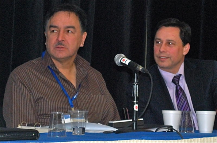 Fort William First Nation Chief Peter Collins (left) and the Honourable Brad Duguid, Minister of Aboriginal Affairs, attend the opening of the first-ever Ontario First Nations Economic Forum, January 14, 2010, at Fort William First Nation near Thunder Bay, Ontario.