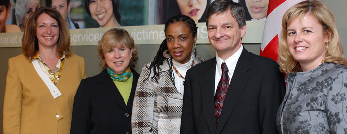 Pictured with the Attorney General are (from left to right): Ruth Campbell, Chair, Office for Victims of Crime; The Hon. Deb Matthews, Minister of Children and Youth Services and Minister Responsible for Womens Issues