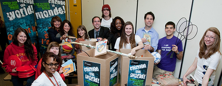 Northern Secondary School students in Toronto help Minister Eric Hoskins (third from right) with a book and sporting goods drive to kick off the 3rd annual ChangeTheWorld Ontario Youth Volunteer Challenge.
