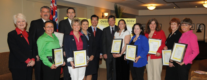 Attorney General Chris Bentley (back centre) with colleagues and 2010 Victim Services Awards of Distinction recipients