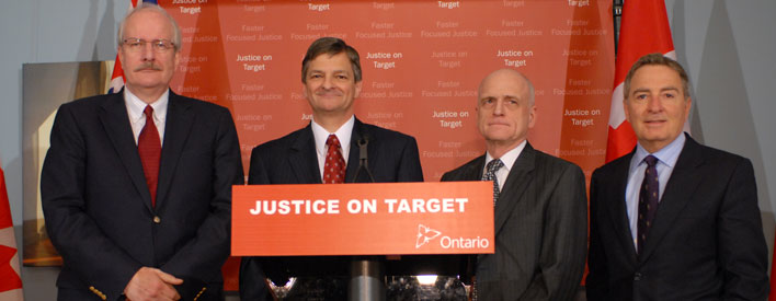 Attorney General Chris Bentley (second from left) is joined by Senior Crown Attorney Kenneth Anthony, Senior Regional Justice Bruce Durno and Parliamentary Assistant to the Attorney General David Zimmer at the launch of Justice on Target in Toronto.