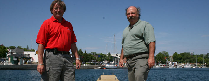 The Northern Ontario Heritage Fund Corporation is providing $1.1 million to the Town of Northeastern Manitoulin and the Islands (NEMI) to complete the second phase of its docks and waterfront facility project. The current project includes constructing docks with 28 slips as well as building a wharf that will serve as a breakwater and dock for larger cruise ships. Greg Wright (left), NEMI Manager of Marina Services and Councillor Al MacNevin are seen on the new docks in Little Current.
