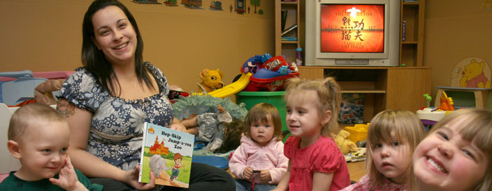 Children and Irene Levesque, proprietor of Little Steps Daycare in Thunder Bay, settle in for story time.