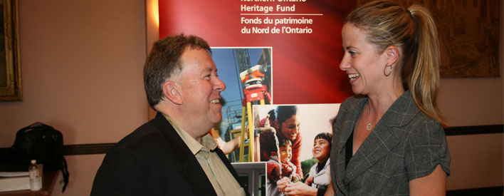 Tuesday, July 15, 2008 -- Owner and proprietor of Forever Yours, Chantal Boucher (right), speaks with Northern Development and Mines Minister Michael Gravelle (left), following a news conference in Kapuskasing. During the news conference Minister Gravelle announced that the Northern Ontario Heritage Fund Corporation (NOHFC) has approved funding of $24,395 through its Young Entrepreneur Program to help Boucher purchase equipment, furniture and support other start-up costs for her business.