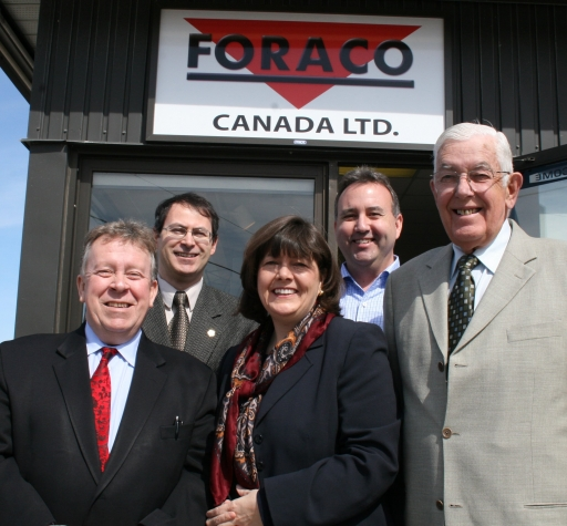 Michael Gravelle, Minister of Northern Development and Mines and Chair of the Northern Ontario Heritage Fund Corporation (NOHFC), and Monique Smith, MPP for Nipissing, announced a $1-million loan from the NOHFC for Foraco Canada Ltd. to invest in new diamond drilling equipment. They were joined at Foraco's North Bay office by (front row, far right) Jack Burrows, NOHFC board member, (back row, left) Roy Slack, Chair of the local chapter of the Canadian Institute of Mining, Metallurgy and Petroleum, and Tim Bremner, President of Foraco Canada Ltd. The funding was provided through the NOHFC's Enterprises North Job Creation Program.