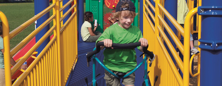 This is a picture of a child playing at the accessible playground in the Town of Thorold.