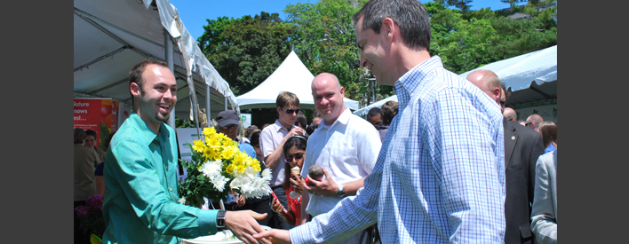 The farmers' market crowd makes Premier McGuinty feel welcome.