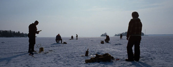 Ice fishing on a frozen lake