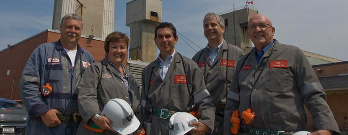 Outside the Sifto Canada Inc. salt mine in Goderich. From left: Mine Manager Rowland Howe, Huron-Bruce MPP Carol Mitchell, Minister Fonseca, Compass Minerals C.E.O. Angelo Brisimitzakis, South Huron Mayor Ken Oke.
