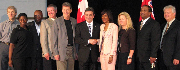 Left to Right: David Soknacki, member of the community and former City Councillor; Trichelle Primo, President, Youth Council, East Scarborough Boys and Girls Club; Ron Rock, Executive Director, East Scarborough Boys and Girls Club; Councillor Paul Ainslie, Ward 43 Scarborough-East; John McKay, MP for Scarborough–Guildwood; Paul Calandra, MP for Oak Ridges–Markham; Margarett Best, Minister of Health Promotion; Co-Pastor Terry Johnston, Global Kingdom Ministries; Kern Kalideen, Executive Pastor, Global Kingdom Ministries; Tom Lodu, Operations Manager, Global Kingdom Ministries.